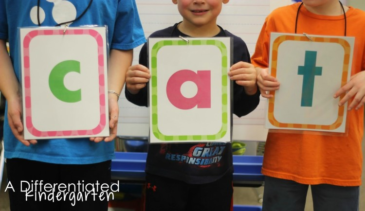 Use these FREE placards to get your students moving while making words in kindergarten. Engaging phonics work.