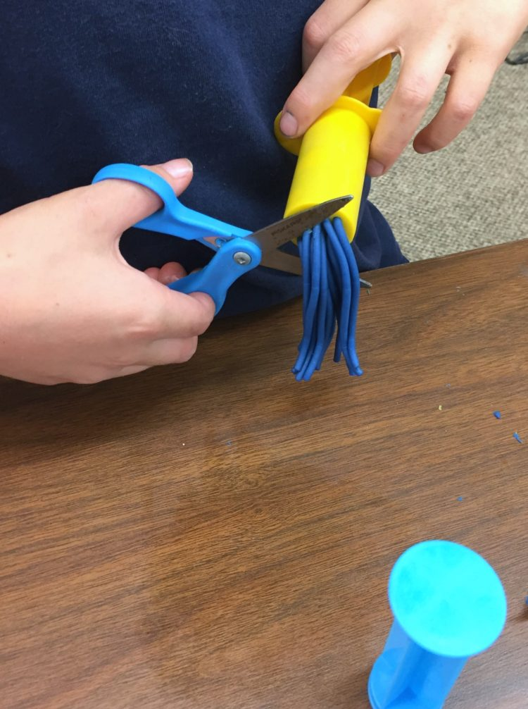 Fine Motor Work Stations In Action in Kindergarten-Play-doh Extruders