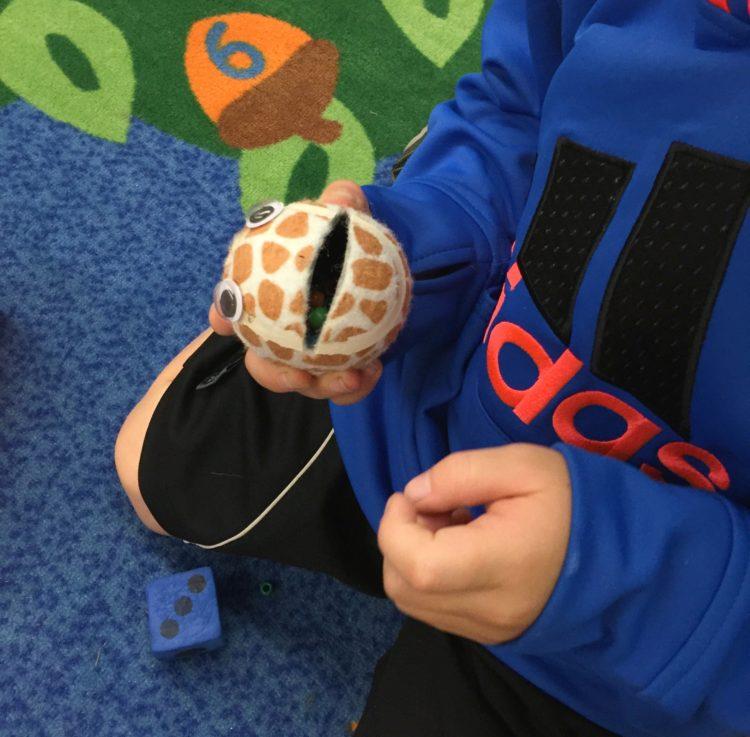 Fine Motor Work Stations In Action in Kindergarten-Tennis Ball Monsters