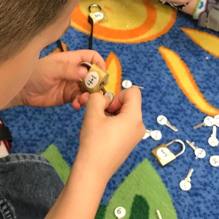 Student using locks and keys in kindergarten