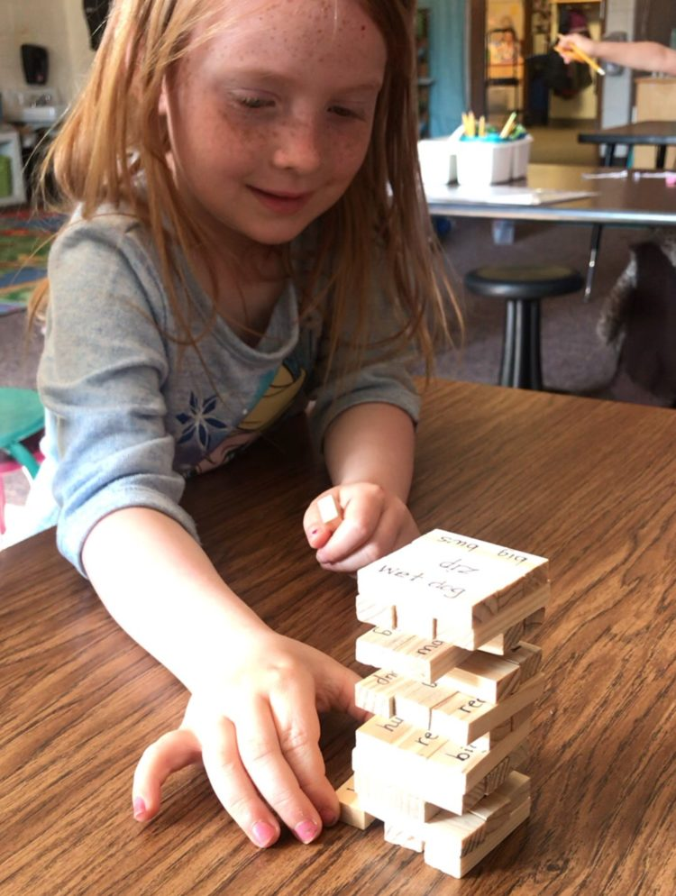 Using games like Jenga to enhance instruction in kindergarten.