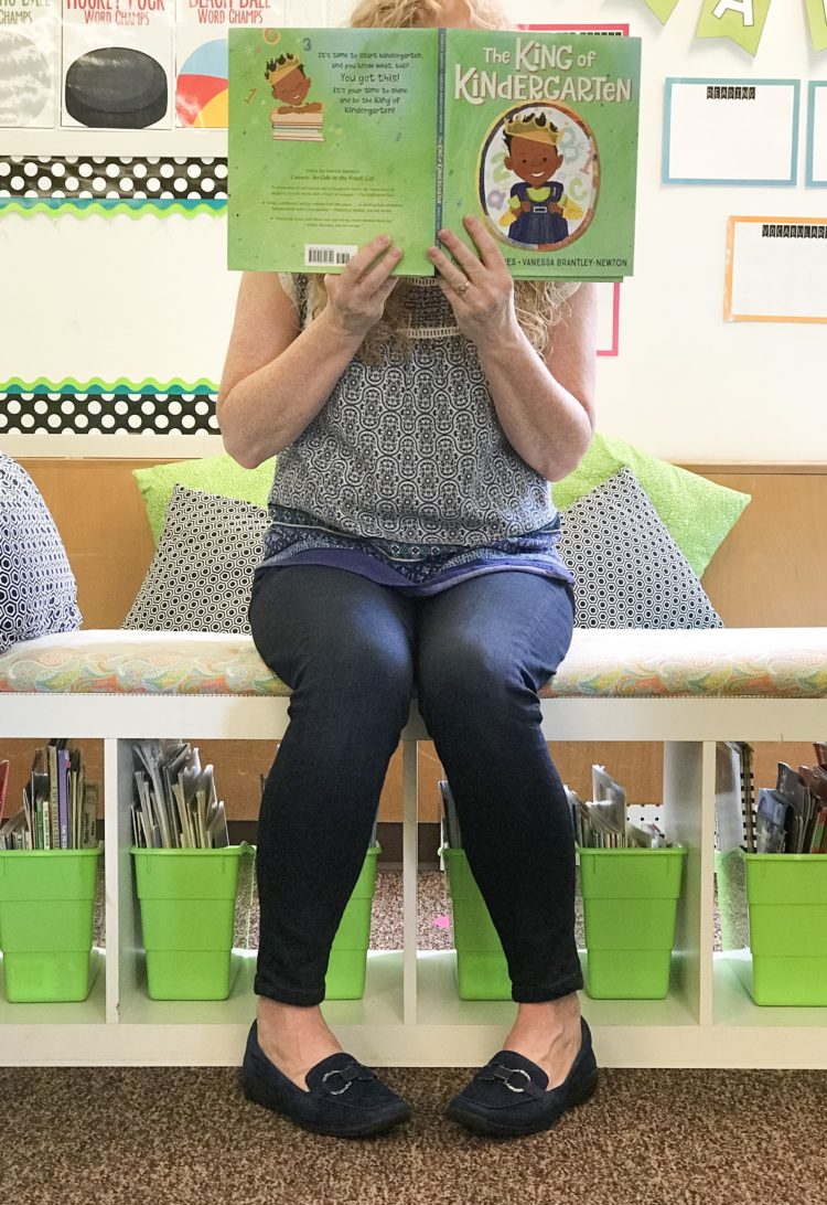 Teacher reading a book wearing EasySpirit loafers.