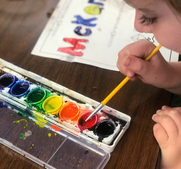 Painting you name in letters and pictures with watercolor paints.